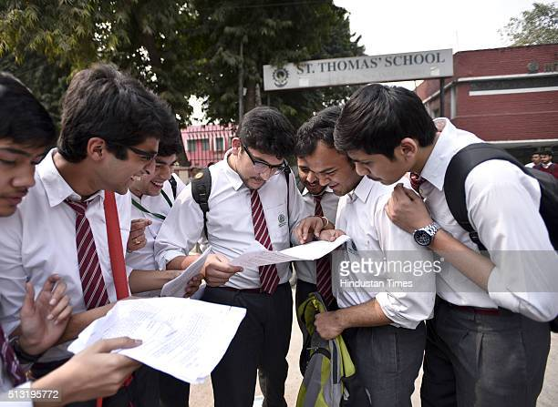 Students discuss about their paper as they come out after giving their Central Board of Secondary Education at Sent Thomas School at Gole Market on...