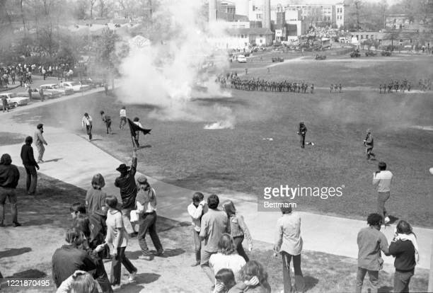 Students disperse as National Guardsmen fire tear gas into a crowd on the commons.