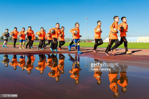Students do physical training at a football training base. Hohhot, Inner Mongolia, China, July 28, 2020.- PHOTOGRAPH BY Costfoto / Barcroft Studios /...