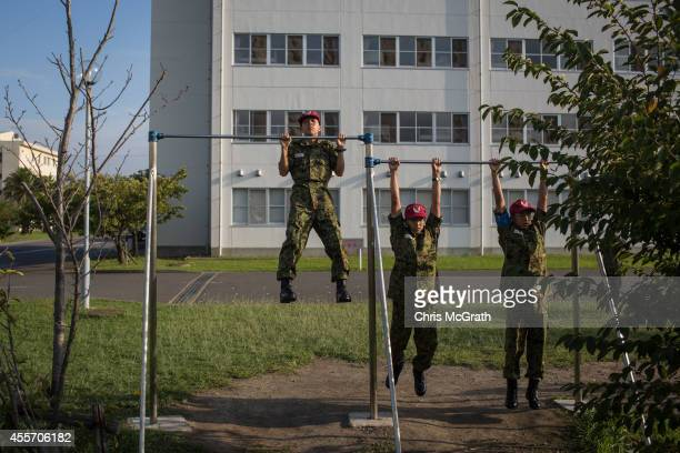 Students do pullups ahead of the mornings marching practice at the Japan Ground SelfDefense Force High Technical School on September 17 2014 in...