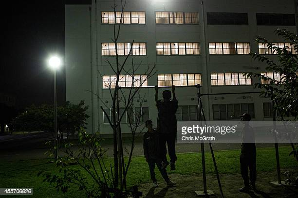 Students do pullups during a moment of free time at the end of the days training at the Japan Ground SelfDefense Force High Technical School on...