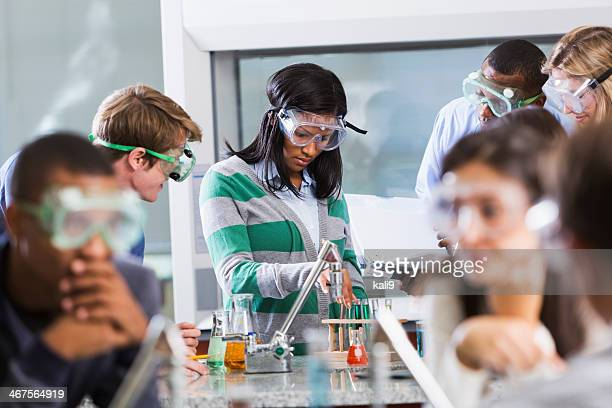 Students doing experiment in chemistry class