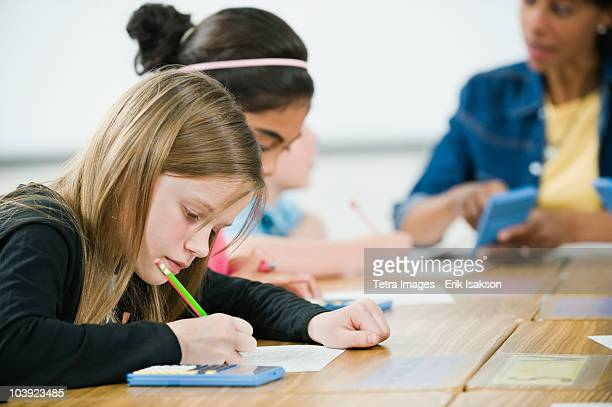 Students doing math work in classroom