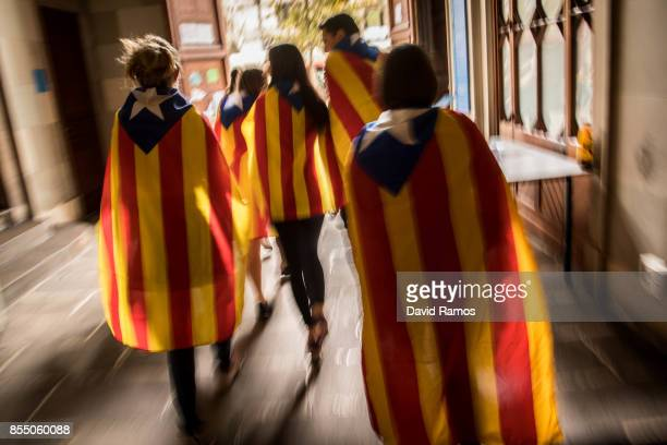 Students draped on Catalan ProIndependence flags leaves the University of Barcelona prior to a demonstration against the position of the Spanish...