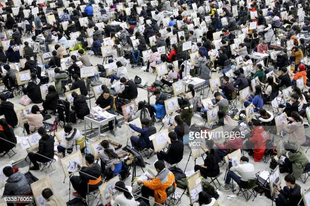 Students draw during the College Entrance Exam for Art at Shungeng International Convention and Exhibition Center on February 5 2017 in Jinan...