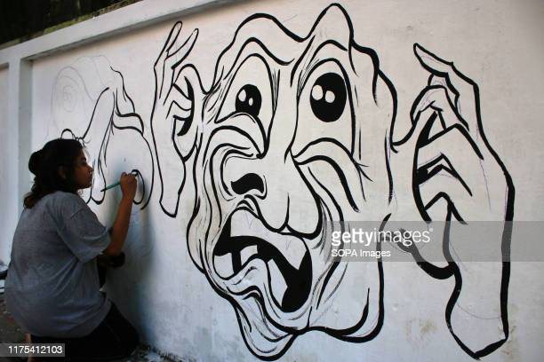 Students drawing a graffiti during the demonstration Students of Bangladesh University of Engineering and Technology protested with graffiti and...