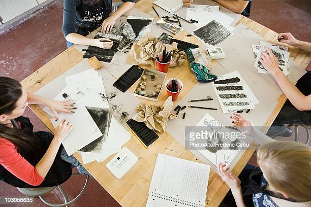 Students drawing with charcoal in art class