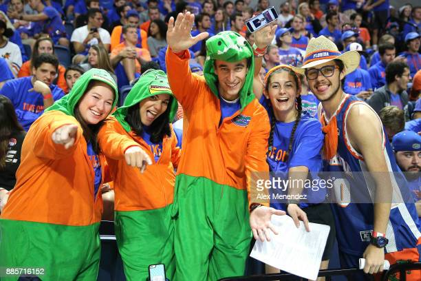 Students dressed as alligators are seen prior to the start of a NCAA basketball game between the Florida State Seminoles and the Florida Gators at...