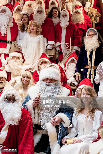 Students dressed as Santas and angels gather for their annual preChristmas gathering at the cafeteria of the Studentenwerk Nord student support...