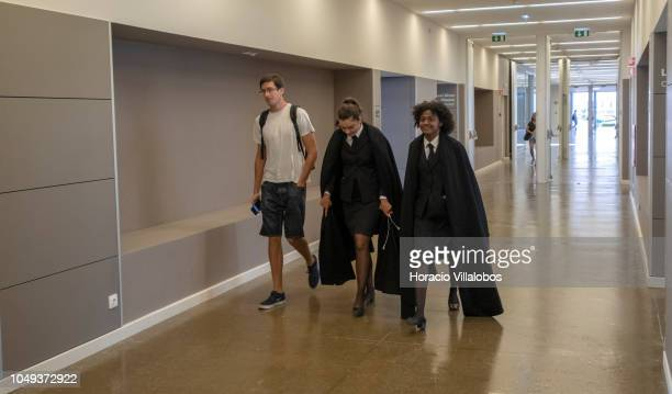 Students dressed in university formal attire walk on one of the hallways at NOVA School of Business and Economics new campus on October 04 2018 in...