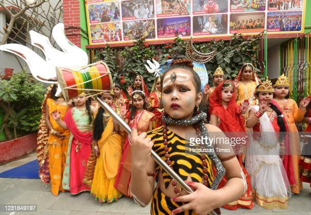 Students dressed up as Hindu deity Shiv and Parvati during Maha Shivratri festival at Tender Hearts International School, on March 11, 2021 in Patna,...