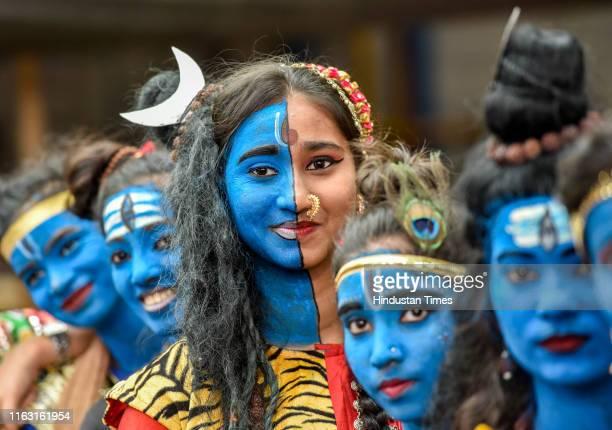 Students dressed up as Hindu gods Lord Krishna and Lord Shiva during Janmashtami festival celebration at Shreemati Nathibai Damodar Thackersey...