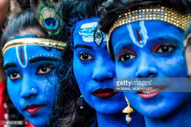 TOPSHOT Students dressed up as Hindu gods Lord Krishna and Lord Shiva participate in a cultural event in their school in Mumbai on August 21 2019