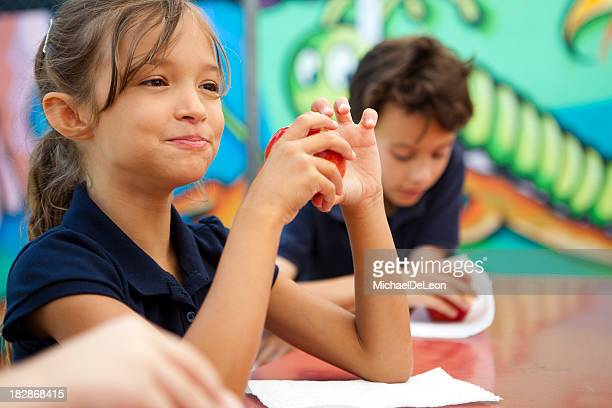students during lunch break. - kid girl eating apple stock photos and pictures