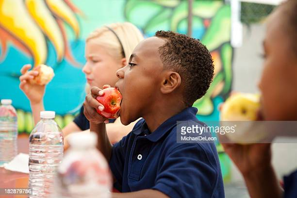 students during lunch break. - apple fruit stock photos and pictures