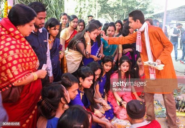 COLLEGE GUWAHATI ASSAM INDIA Students during Saraswati Puja at Cotton College Saraswati Puja celebrated with great enthusiasm throughout the country