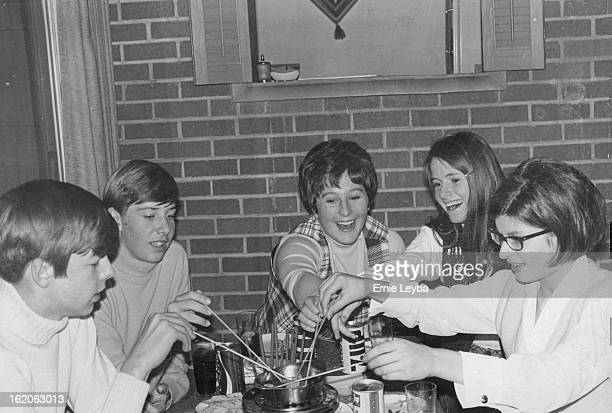 MAR 29 1970 Students Eat German fondue dish during a 'Reunion' at home of Mr and Mrs Bryce Jackson 409 S Wolff St From left Horst Waldmann Bremen...