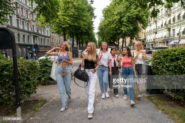 Students eat ice-cream at the end of their first day back to school since the March shut down, on August 21, 2020 in Stockholm, Sweden. The high...