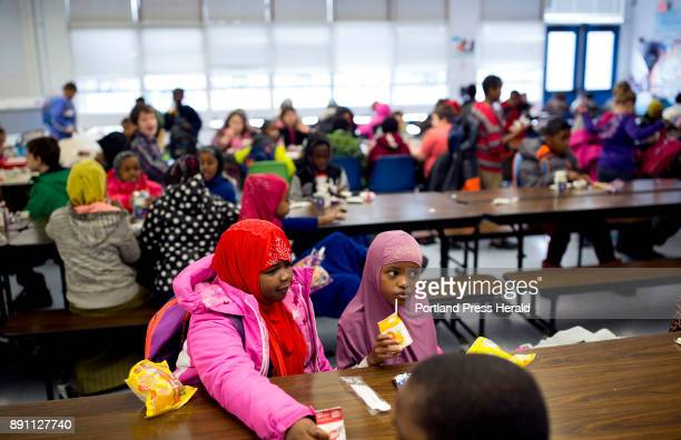 Students eat their breakfast at Longley Elementary School before the start of class Longley's demographic makeup has changed dramatically in the past...