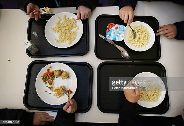 Students eat their lunch in the canteen at a secondary school on December 1 2014 in London England Education funding is expected to be an issue in...