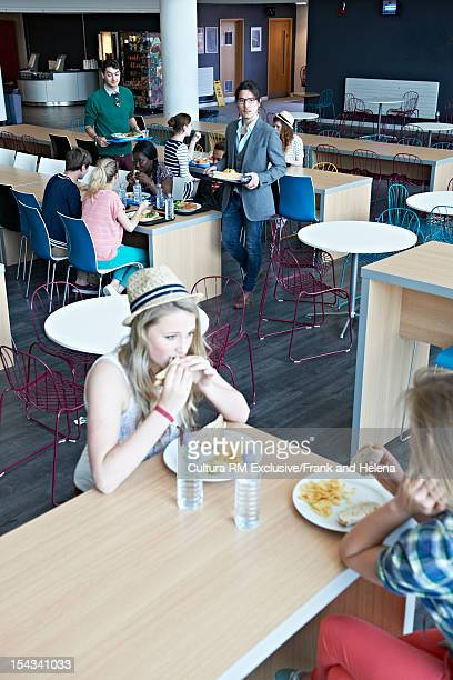 Students eating together in cafeteria