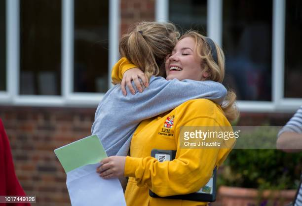 Students embrace each other after opening their A Level exam results at Lady Eleanor Holles school on August 16 2018 in Hampton United Kingdom A...