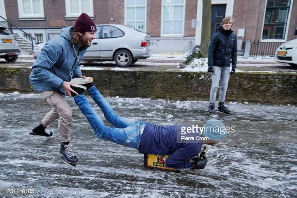 Students enjoy the frozen canals on February 13, 2021 in Delft, Netherlands. Parts of central and northern Europe and Britain have experienced...