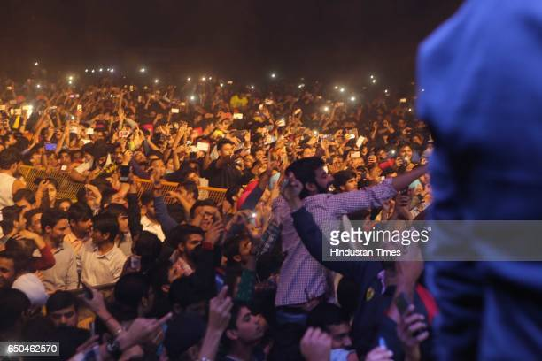 Students enjoy the performance of Punjabi actor and singer Diljit Dosanjh during the Confluence 2017 Hansraj College Annual Cultural Fest on March 6...