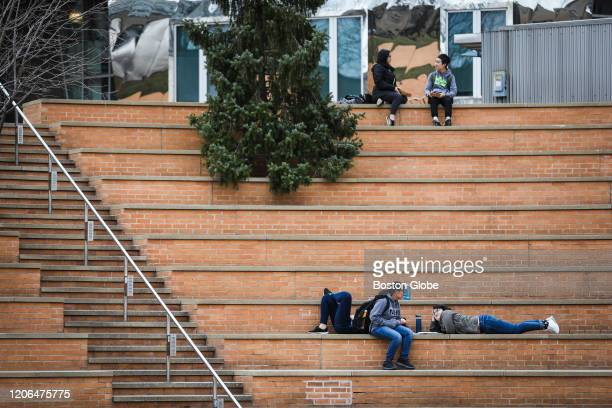 CAMBRIDGE MA MARCH 10 Students enjoy the warm weather while hanging out on the campus of MIT in Cambridge MA on March 10 2020 Some colleges have...
