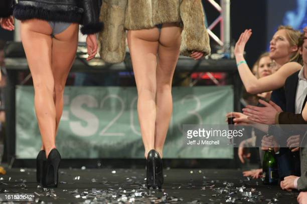 Students enjoy themselves during the UK's largest student run fashion show held at the University of St Andrews on February 16 2013 in St Andrews...