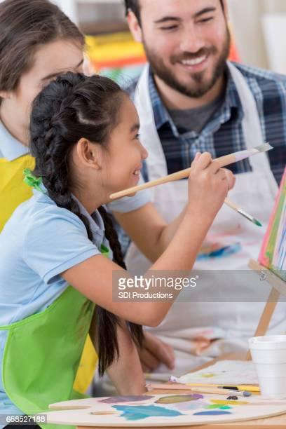 Students enjoying art class