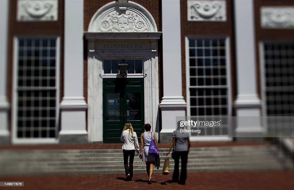 Students enter a building in this photo taken with a tilt shift lens at Harvard University's Business School in Cambridge, Massachusetts, U.S., on Monday, Aug. 6, 2012. Harvard University, an American private Ivy League research university established in 1636, is the oldest institution of higher learning in the United States and the first corporation chartered in the country. Photographer: Brent Lewin/Bloomberg via Getty Images