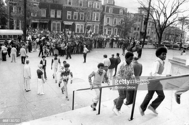 Students enter a school in South Boston on the first day of federally imposed desegregation on Sep 12 1974 Twentythousand students have been assigned...
