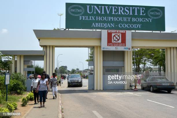Students enter Felix Houphouet-Boigny university in Abidjan as classes start again on March 4, 2019 after 6 weeks of strike by the teachers. - The...