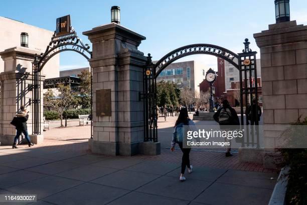 Students enter Kogan Plaza at George Washington University campus Washington DC