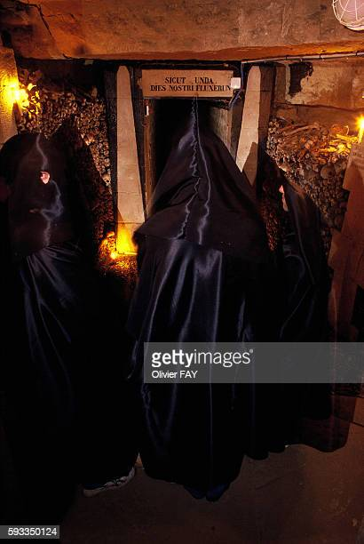 Students entering the Ecole des Mines de Paris wear municipal shrouds for the initiation ceremony in a room called Fontaine de la Samaritaine or the...