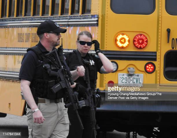 May 7: Students escorted school bus in front of STEM School Highlands Ranch after a shooting. May 7, 2019.