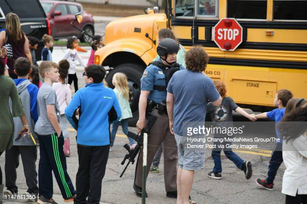 Students escorted school bus in front of STEM School Highlands Ranch after a shooting May 7 2019
