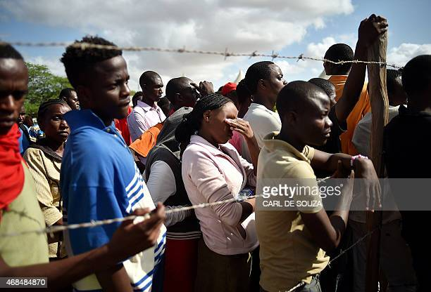 Students evacuated from Moi University listen to an address by Interior Minister for Security Joseph Ole Nkaissery before they are transported to...