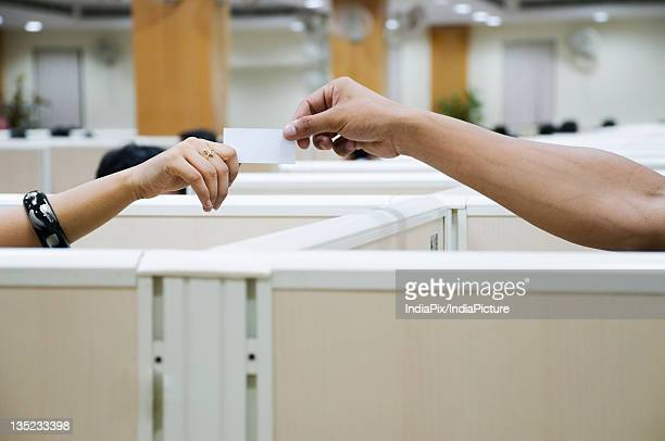 Students exchanging a note