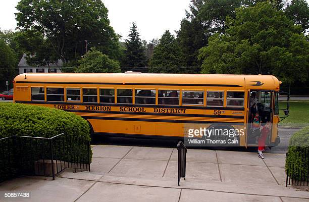 Students exit a school bus at Merion Elementary School student May 19 2004 in Lower Merion Pennsylvania The Lower Merion School District is taking...