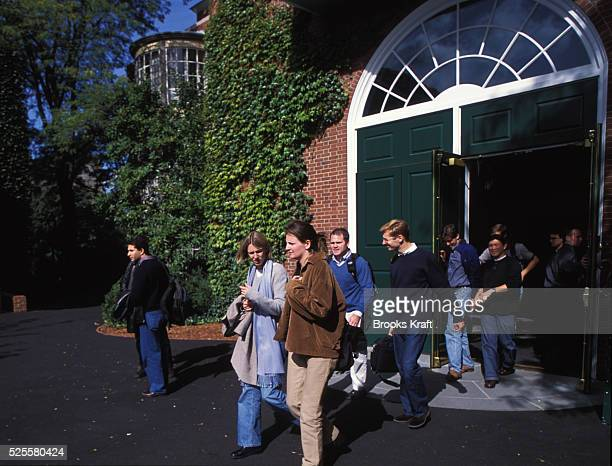 Students exit the Harvard Business School located in Boston which is one of the graduate schools of Harvard University and one of the world's leading...