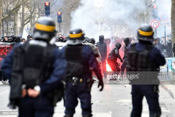 TOPSHOT Students face riotpolice during a demonstration on March 22 2018 in Paris as part of a nationwide day of protest against French president...