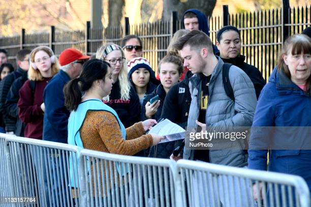 Students faculty and staff line up outside an emergency clinic at Temple University in Philadelphia PA on March 27 2019 for immunization shots on...