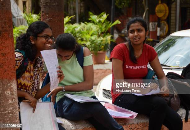 Students filling the admission form at MMCC College, on June 25, 2019 in Pune, India.
