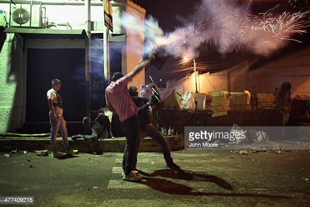 Students fire a homemade mortar tube towards security forces before dawn on March 9 2014 in San Cristobal the capital of Tachira state Venezuela...