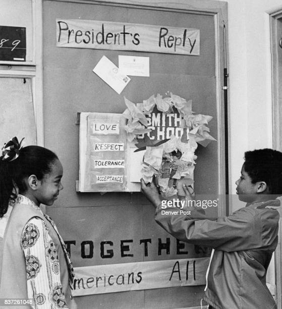 Students Fix Up School Bulletin Board Mariea Denny 3380 Magnolia St watches Anthony Fowler 3665 Niagara St Students wrote to President Nixon Credit...