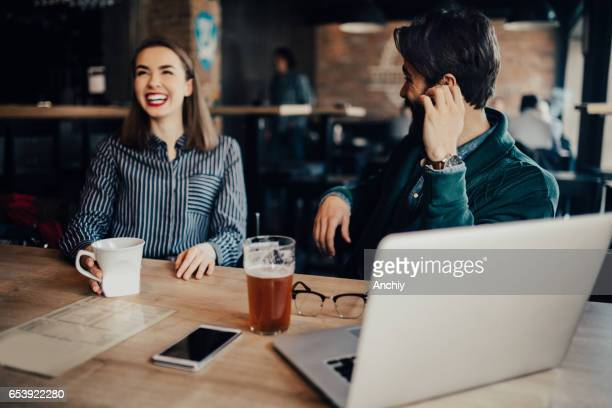Students flirting in a bar