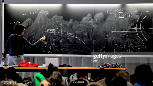 Students follow a course at the Roma Tre university on November 27 2012 in Rome About 870 teachers are working in the eight faculties of the...