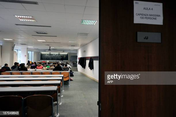 Students follow a lesson during a lesson in a biology laboratory at the Roma Tre university on November 27 2012 in Rome About 870 teachers are...